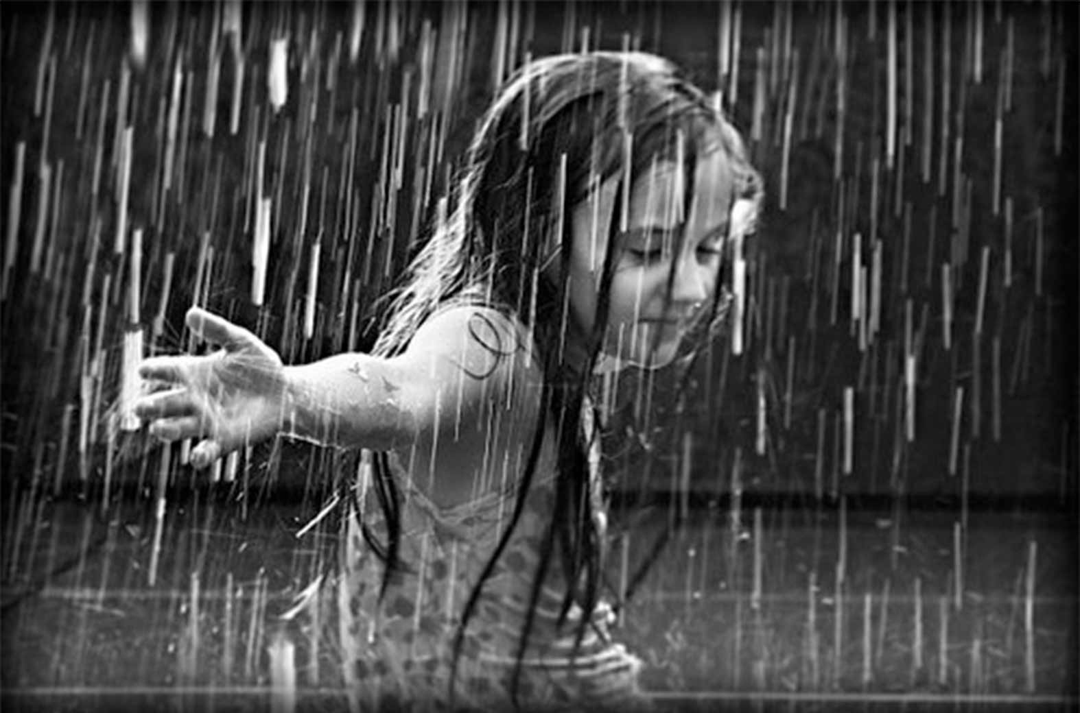 Young girl dancing in the rain embodies the raw power of photography